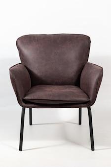 Closeup shot of a dark brown leather armchair
