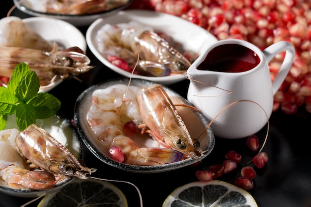 Closeup shot of delicious seafood with shrimps decorated with pomegranates
