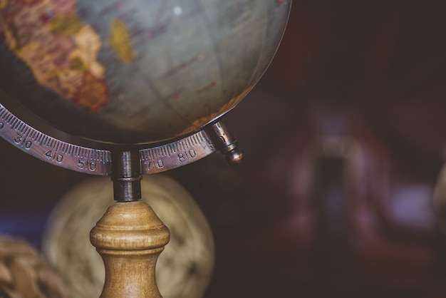 Closeup shot of a desk globe with a blurred background