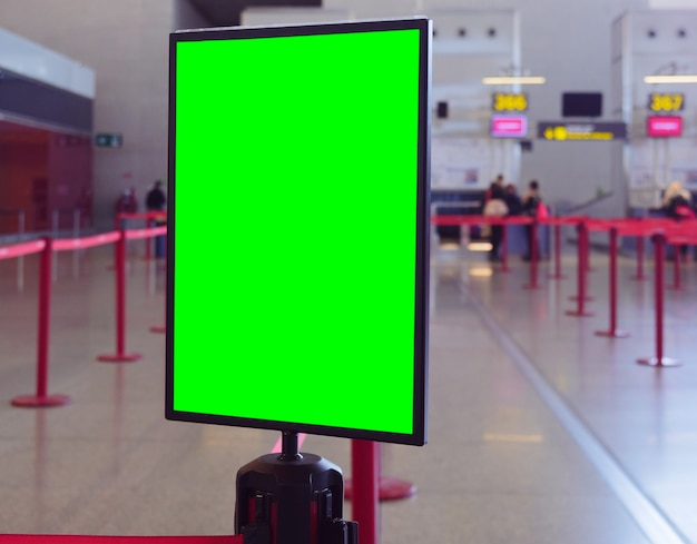 Closeup shot of a display board with a green space for your image in a commercial building