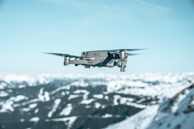 Closeup shot of  drone over a beautiful mountainous landscape covered with snow
