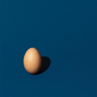 Closeup shot of an egg on a blue background
