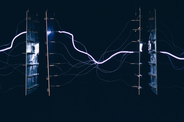 Closeup shot of electrical chipsets transmitting energy through each other