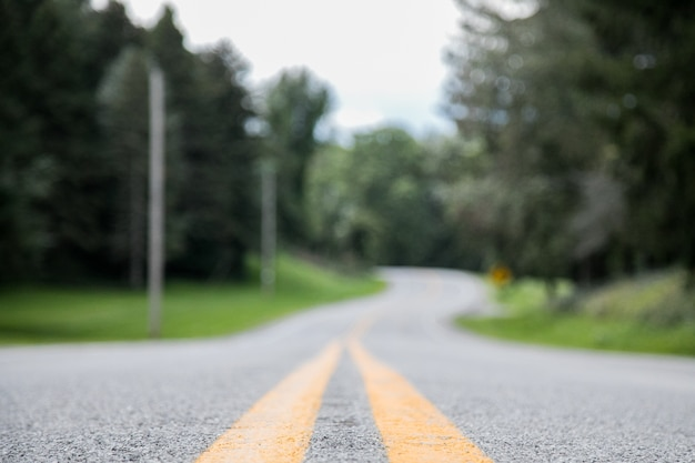 Closeup shot of an empty road with a blurred distance
