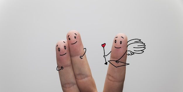 Closeup shot of finger couple in love, with cupid finger aside