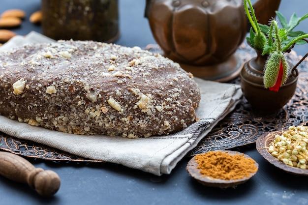 Closeup shot of fresh raw vegan bread on a rustic background