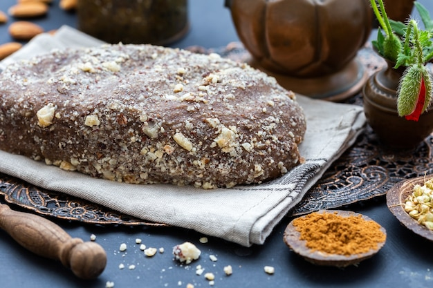 Closeup shot of fresh raw vegan bread on a rustic surface