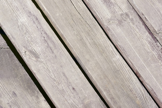 Colpo del primo piano della superficie di legno grigia
