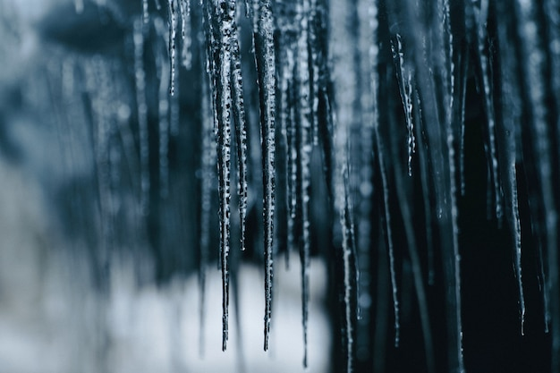 Closeup shot of hanging spiky frozen icicles