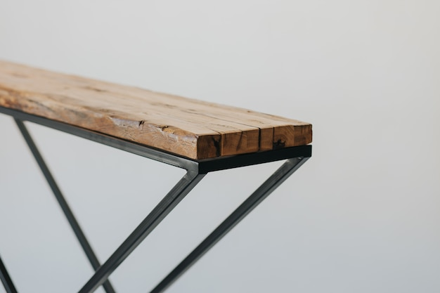 Closeup shot of an ironing board made of a wooden surface