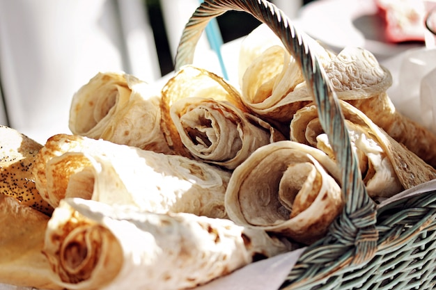 Closeup shot of lavash rolls in a basket