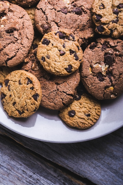 Closeup shot of a lot of chocolate chip cookies in a white plate