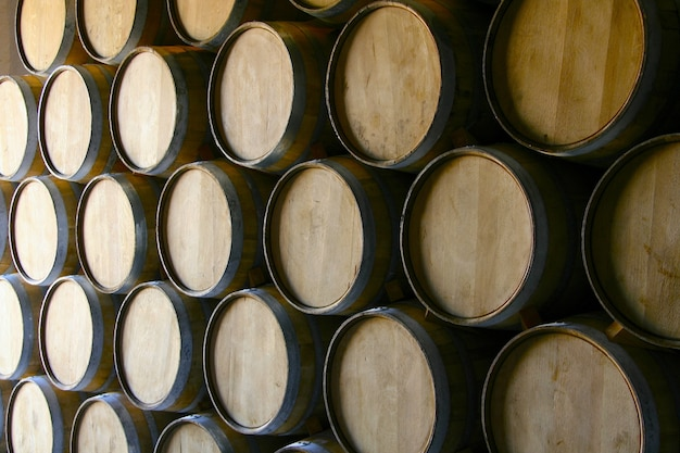 Closeup shot of a lot of wooden wine barrels