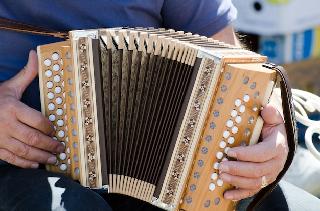 Closeup shot of a male playing the accordion