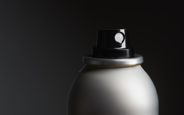 Closeup shot of a metal bottle with spray