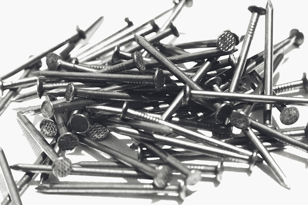 Closeup shot of metal nails on a white surface