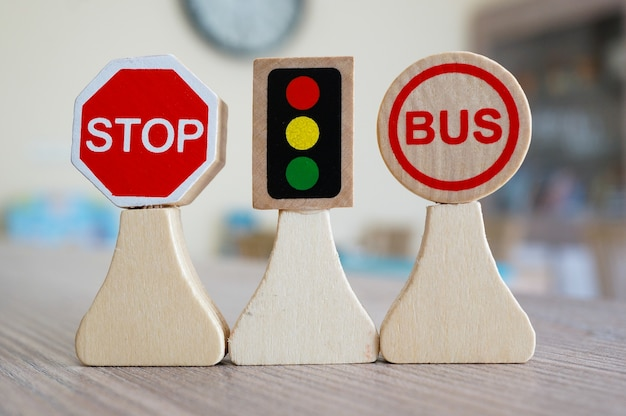 Closeup shot of miniature wooden road signs on a table