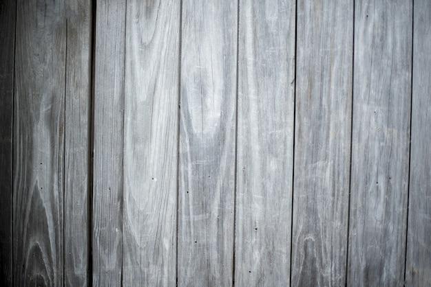 垂直灰色の木板の背景で作られた壁のクローズアップショット