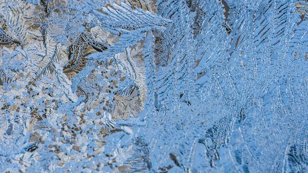 Макрофотография выстрел из красивых моделей мороза и текстуры на стекле