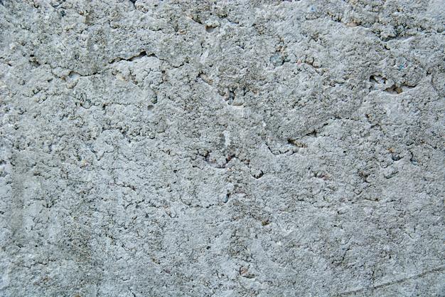 Макрофотография выстрел из естественно выветривания шероховатый стены с остатками масляной краски на мраморе