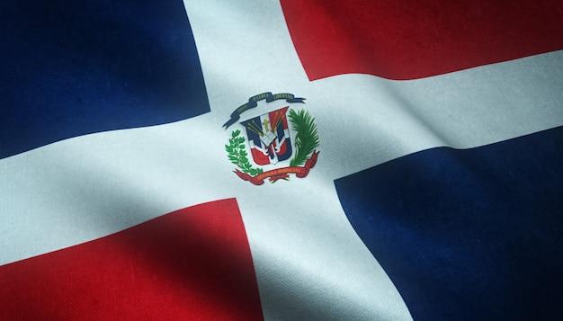 興味深いテクスチャとドミニカ共和国の旗を振ってのクローズアップショット