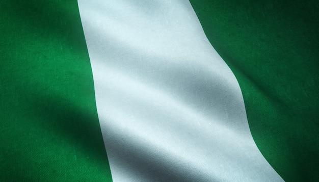 興味深いテクスチャでナイジェリアの手を振っている旗のクローズアップショット