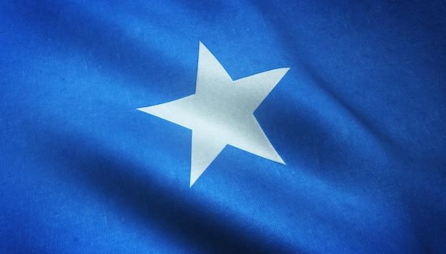 興味深いテクスチャでソマリアの手を振っている旗のクローズアップショット