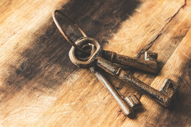 Closeup shot of old rusted keys on a wooden surface