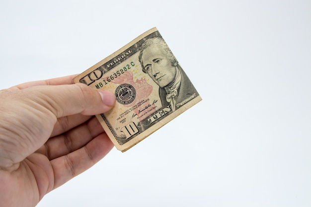 Closeup shot of a person holding a dollar bill over a white background