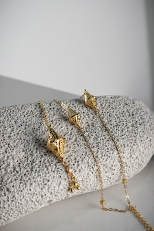 Closeup shot of pieces of expensive golden jewelry in a store
