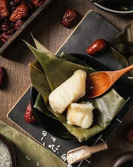 Closeup shot of preparation of rice dumpling with banana leaves