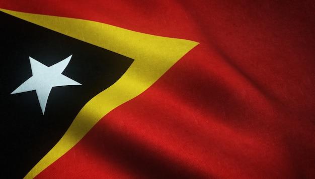 Colpo del primo piano della bandiera realistica di timor orientale con trame interessanti