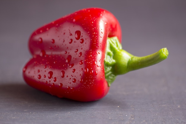 Closeup shot of red pepper with droplets of water on it