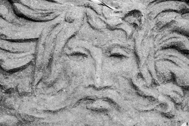 Closeup shot of a stone face carving