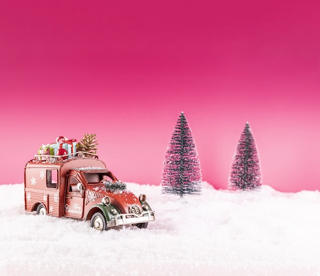 Closeup shot of a toy car for christmas decoration on snow