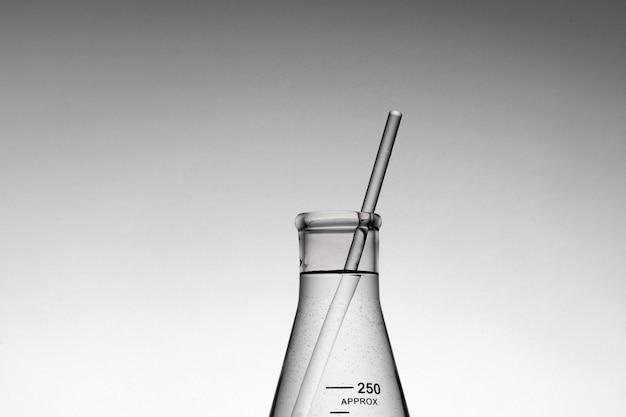 Closeup shot of a tube inside an erlenmeyer beaker