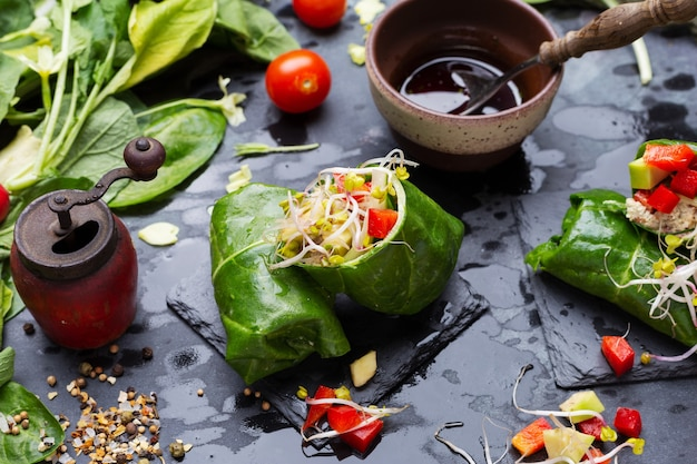 Closeup shot of a vegan wrap with red peppers and tomatoes