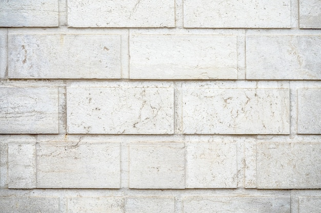 Closeup shot of a wall made of white rectangular stones background
