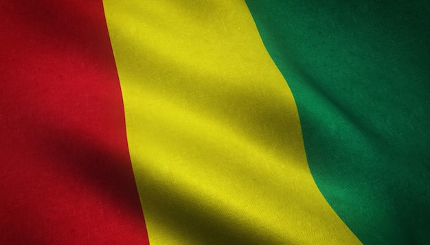 Closeup shot of the waving flag of guinea with interesting textures