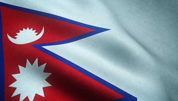 Closeup shot of the waving flag of nepal