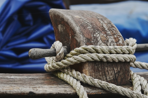 Closeup shot of a white rope tied on wood