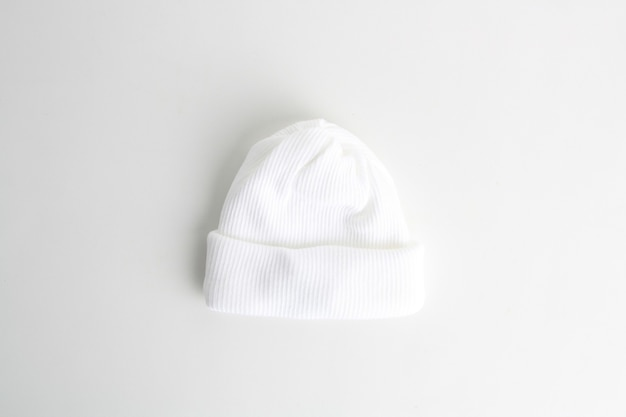 Closeup shot of a white wool baby hat isolated on a white background