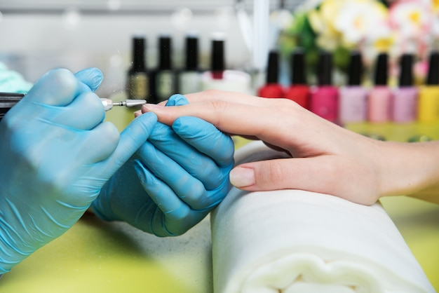 Closeup shot of a woman in a nail salon receiving a manicure