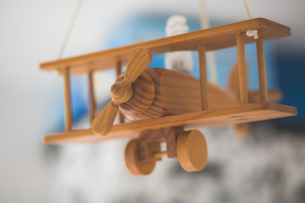 Closeup shot of a wooden miniature old airplane with a blurred background