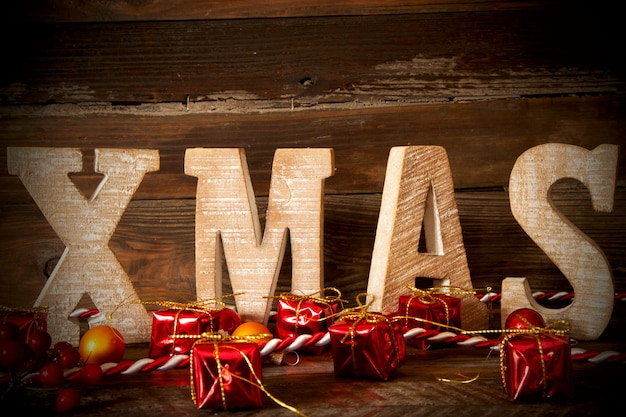 Closeup shot of xmas big wooden letters on a wooden board