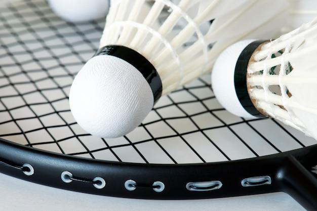 Closeup of shuttlecock and racket