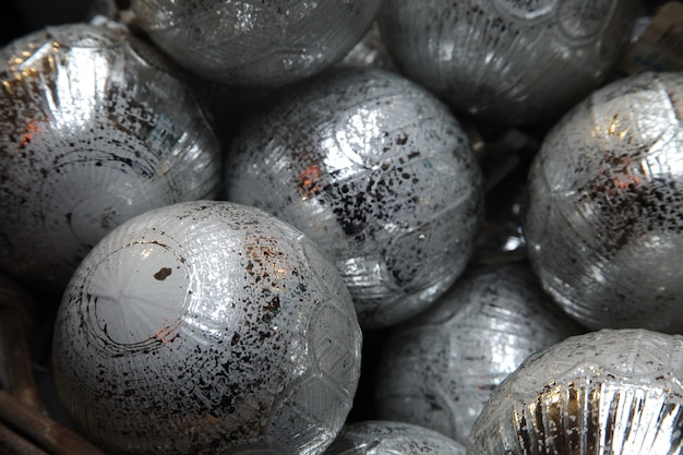 Closeup of the silver baubles of a christmas tree