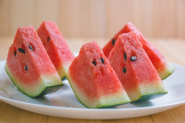 Closeup slice pieces of refreshing watermelon on a wooden space