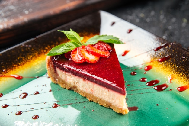 Closeup on a slice of strawberry cheesecake