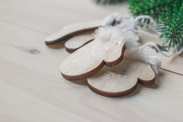 Closeup of small wooden ornament gloves on the table under the lights